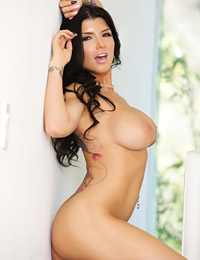 Romi rain oozes sexiness as she slowly shows off her bits.