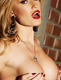 Beautiful blonde angela sommers slips off her tight corset